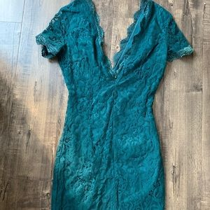 Teal lace body con dress with low v neck